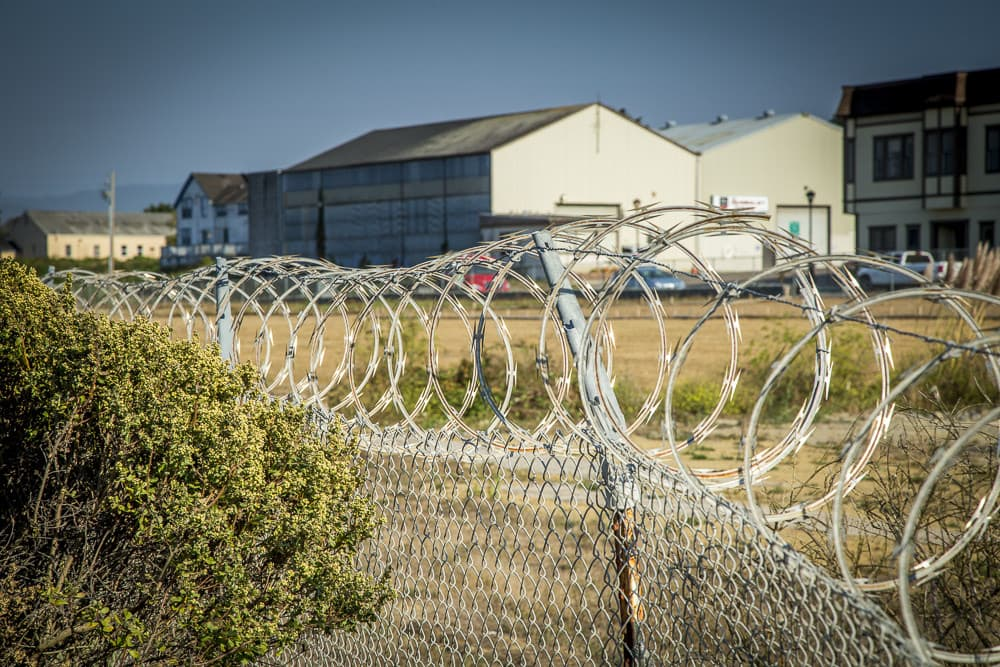 Installed razor wire on the existing fence
