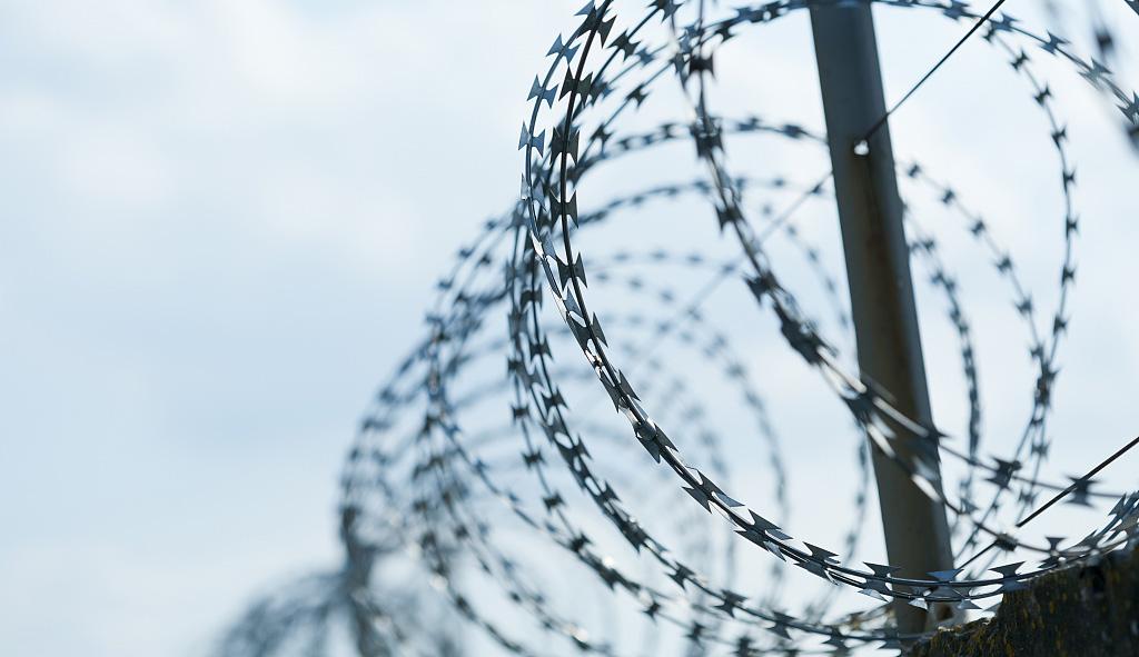 A razor wire fence on sky